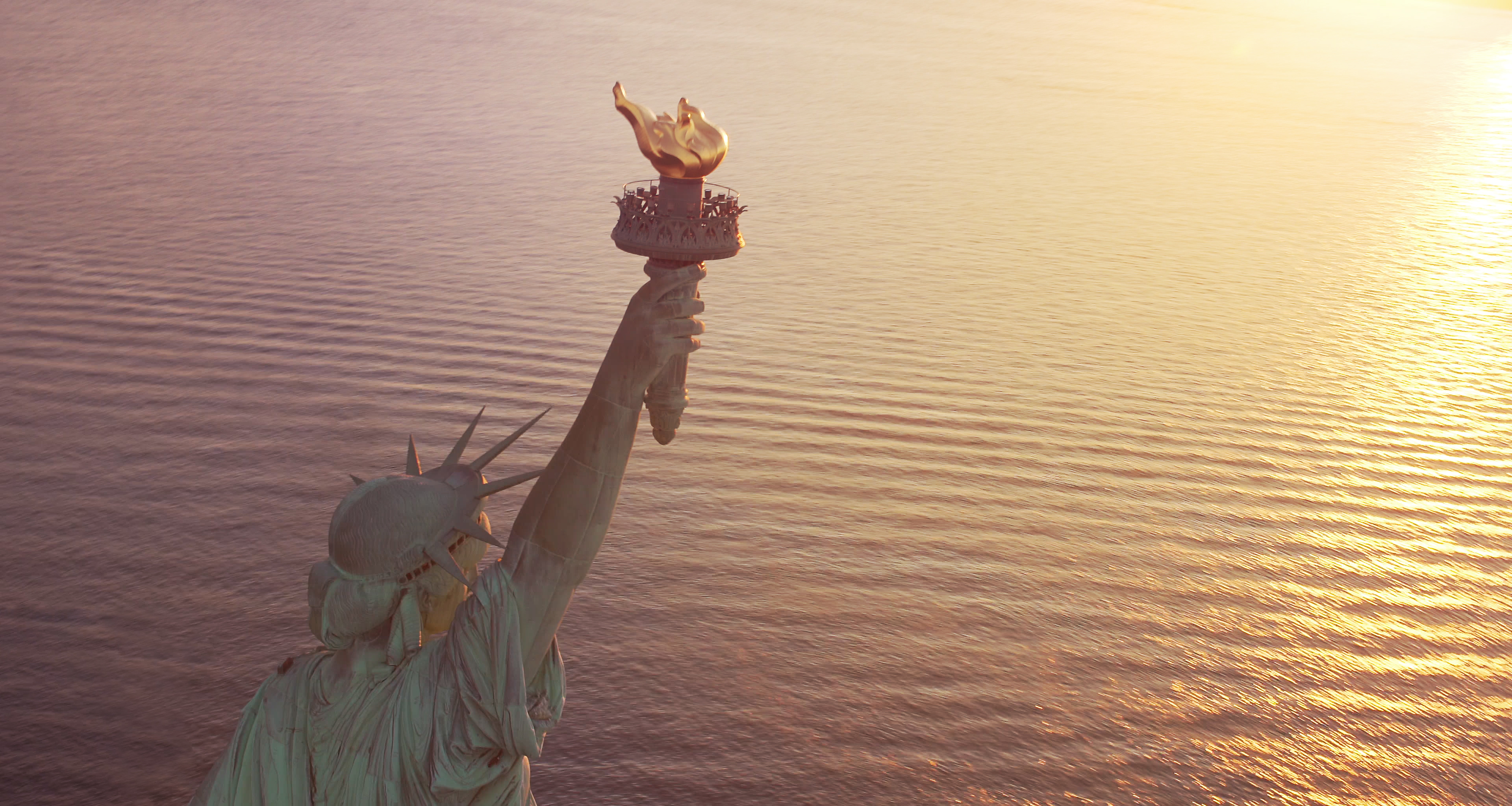 Statue of Liberty at sunrise with copy space